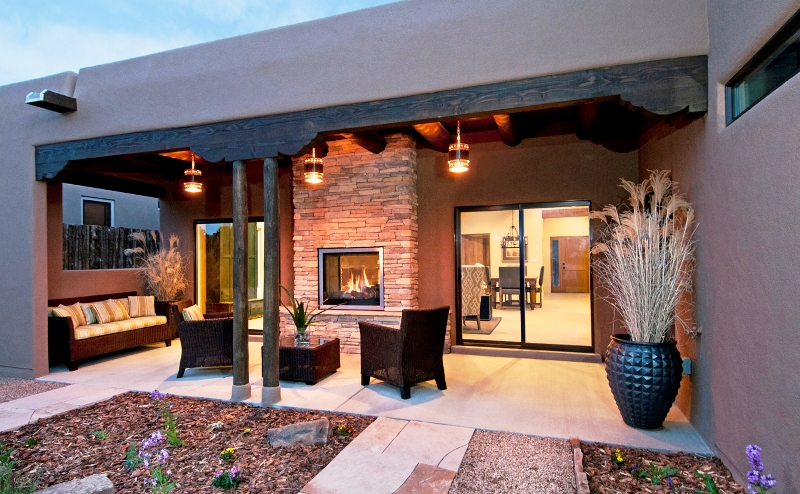 A photo of the back patio of a home typical of the UNM area of Albuquerque