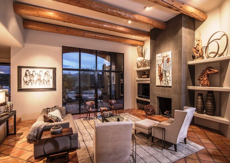 A rustic, western themed home in the Albuquerque foothills with modern furnishings and equine art