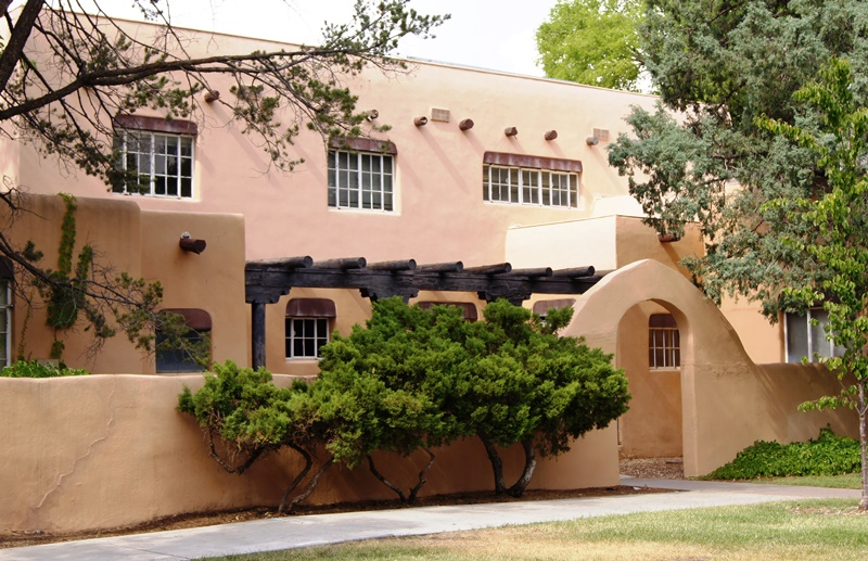 A photo of a pueblo style building near the UNM Business Center